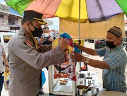 Penjual Kue Pancong Sambut Gembira Baksos Polres Mempawah di Pasar Sebukit Rama