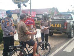 Laksanakan Instruksi Kapolri, Polisi di Jungkat Turun ke Jalan Berikan Edukasi Prokes